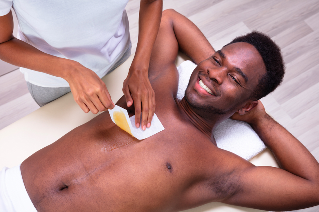 Man getting his chest waxed