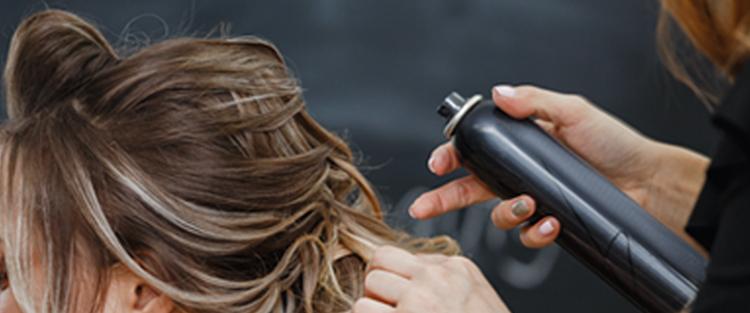 Person getting hair spray