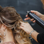Woman getting hair spray